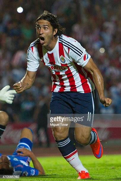 Aldo De Nigris of Chivas celebrates after scoring his team's second goal during a Championship match between Puebla and Chivas as part of Copa MX...