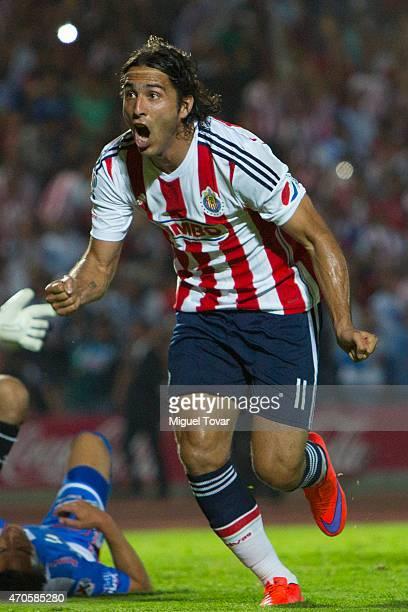 Aldo De Nigris of Chivas celebrates after scoring his team's second goal during a Championship match between Puebla and Chivas as part of Copa MX...