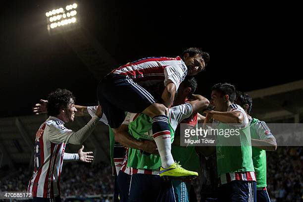 Aldo De Nigris of Chivas celebrates with teammates after scoring during a Championship match between Puebla and Chivas as part of Copa MX Clausura...