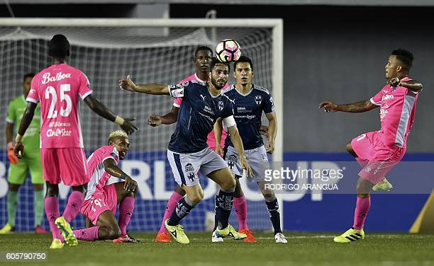 Aldo De Nigris of Mexico's Monterrey vies for the ball with Abdiel Macea and Amilcar Henriquez of Panama's Arabe Unido during their CONCACAF...