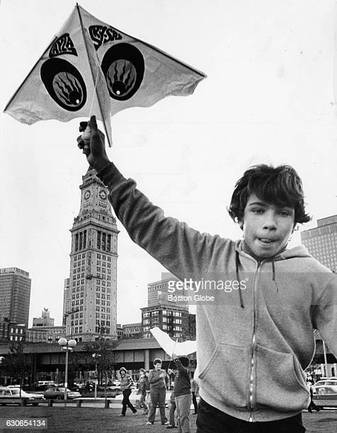 Aldo DiFransesco of the North End runs to launch his kite in the air amid the Boston skyline at Waterfront Park in Boston on Nov 11 1977