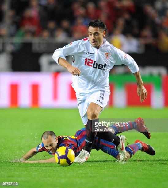 Aldo Duscher of Sevilla beats a fallen Andres Iniesta of Barcelona during the last 16 second leg Copa del Rey match between Barcelona and Sevilla at...