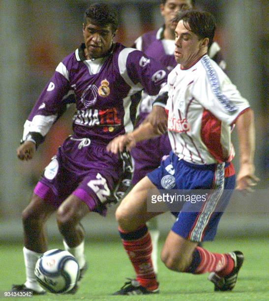 Aldo Gutierrez of the Bolivian Real Potosi soccer team fights for the ball against Lucas Pusineri of San Lorenzo de Argentina 12 March 2002 in Buenos...