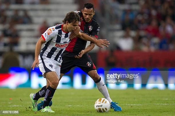 Aldo Leao of Atlas fights for the ball with Omar Arellano of Monterrey during a quarterfinal second leg match between Atlas and Monterrey as part of...