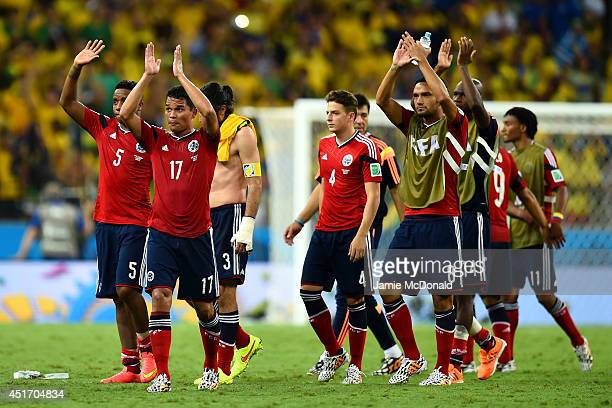 Aldo Leao Ramirez Carlos Bacca and Abel Aguilar of Colombia acknowledge the fans with teammates after being defeated by Brazil 21 during the 2014...