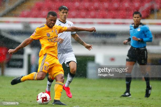 Aldo Lopez of Atlas fights for the ball with Rafael de Souza of Tigres during the match between Atlas and Tigres UANL as part of the friendship...