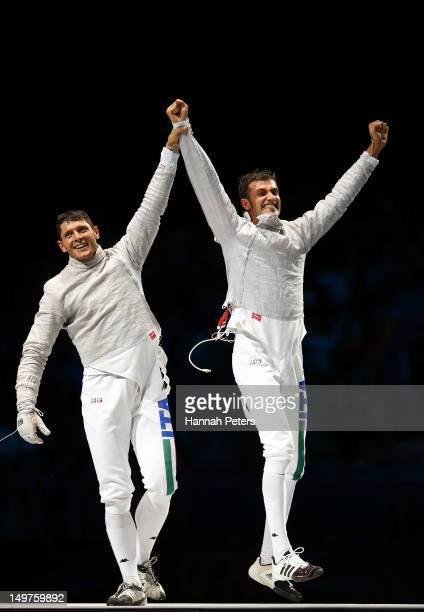 Aldo Montano and Luigi Samele of Italy reacts against after winning the bronze medal by defeating Russia during the Men's Sabre Team Fencing on Day 7...