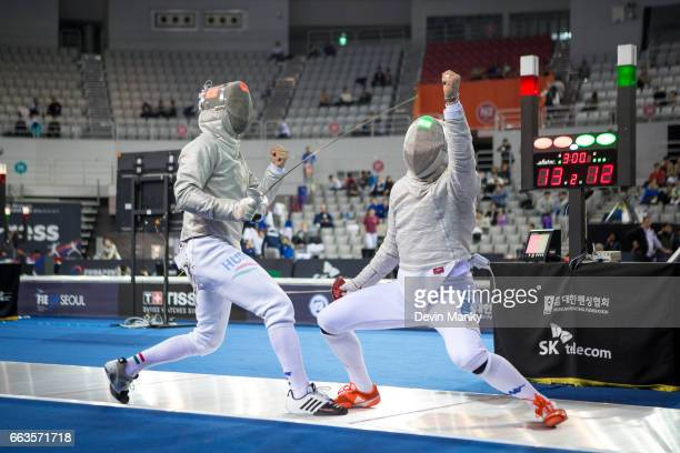 Aldo Montano of Italy and Aron Szilagyi of Hungary both react to making a touch during competition at the SK Telecom Seoul Sabre Grand Prix on April...