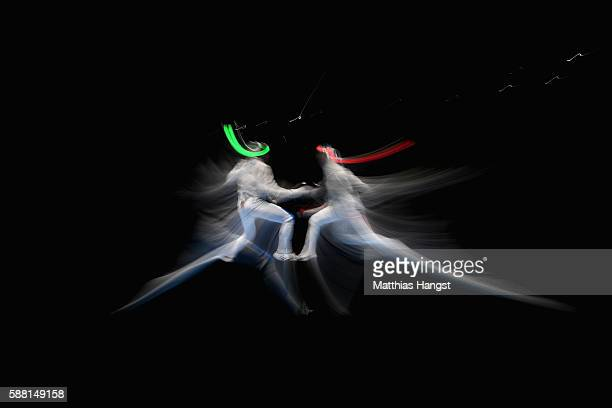 Aldo Montano of Italy and Fares Ferjani of Tunisia compete during the men's individual sabre on Day 5 of the Rio 2016 Olympic Games at Carioca Arena...