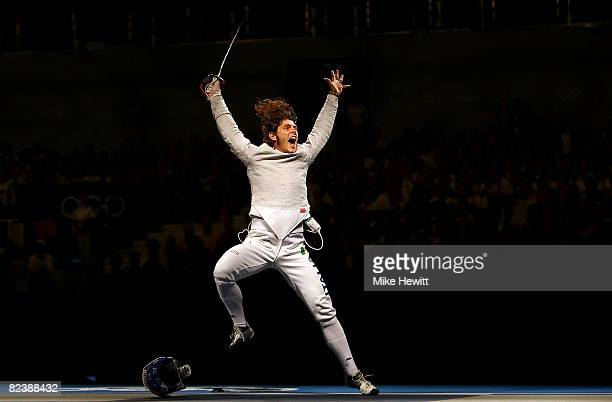 Aldo Montano of Italy celebrates his team sabre fencing bronze medal win over Stanislav Pozdnyakov of Russia at the Fencing Hall of National...