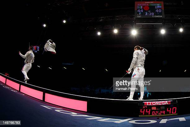 Aldo Montano of Italy competes against Alexey Yakimenko of Russia during the Men's Sabre Team Fencing on Day 7 of the London 2012 Olympic Games at...