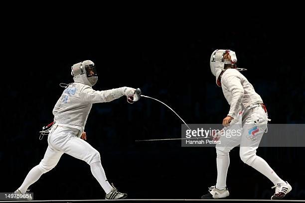 Aldo Montano of Italy competes against Nikolay Kovalev of Russia during the Men's Sabre Team Fencing on Day 7 of the London 2012 Olympic Games at...