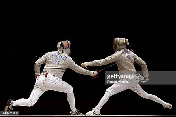 Aldo Montano of Italy competes against Veniamin Reshetnikov of Russia during the Men's Sabre Team Fencing on Day 7 of the London 2012 Olympic Games...