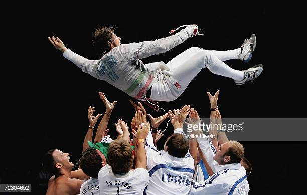 Aldo Montano of Italy is tossed in the air as he celebrates his victory in the men's fencing individual sabre gold medal bout on August 14 2004...