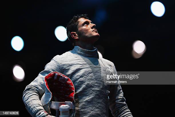 Aldo Montano of Italy waits for a decision against Aliaksandr Buikevich of Belarus during the quarterfinal Men's Sabre Team Fencing on Day 7 of the...