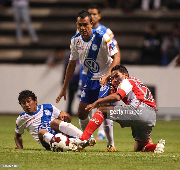 Aldo Polo of Puebla struggle for the ball with Jose Cruzalta of Lobos during a match between Puebla and Lobos BUAP as part of the Copa MX 2012 at...