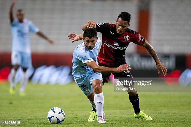 Aldo Ramirez Atlas fights for the ball with Antonio Nelson of Querétaro during a 1st round match between Atlas and Queretaro as part of the Apertura...
