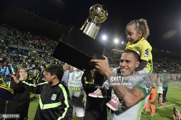 Aldo Ramirez of Nacional celebrates with the trophy after winning a match between Atletico Nacional and Chapecoense as part of CONMEBOL Recopa...
