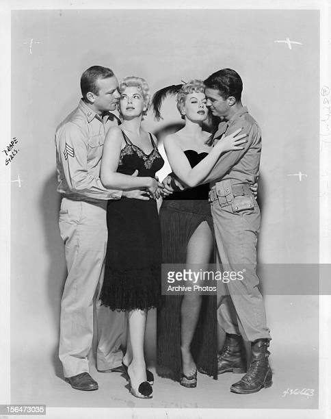 Aldo Ray Barbara Nichols Lili St Cyr and Cliff Robertson embracing each other in publicity portrait for the film 'The Naked And The Dead' 1958