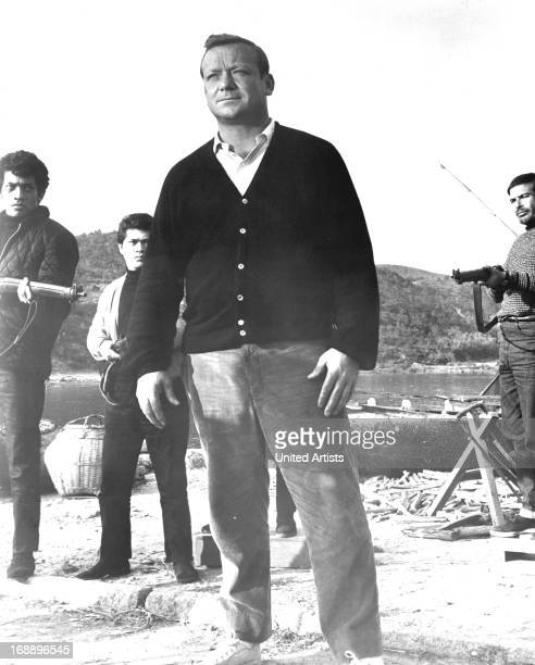 Aldo Ray holds is surrounded in a scene from the film 'Kill A Dragon' 1967
