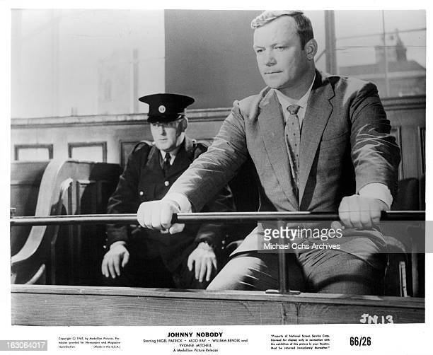Aldo Ray sits in a jury box in a scene from the film 'Johnny Nobody' 1961