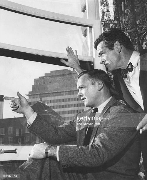 FEB 13 1957 FEB 14 1957 Aldo Ray who visited Denver two years ago points out to Robert Ryan the changes in the skyline since he last visited Denver...