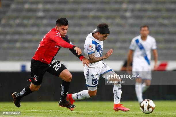 Aldo Rocha of Atlas fights for the ball with Omar Fernández of Puebla during the quarterfinals first leg match between Atlas and Puebla as part of...