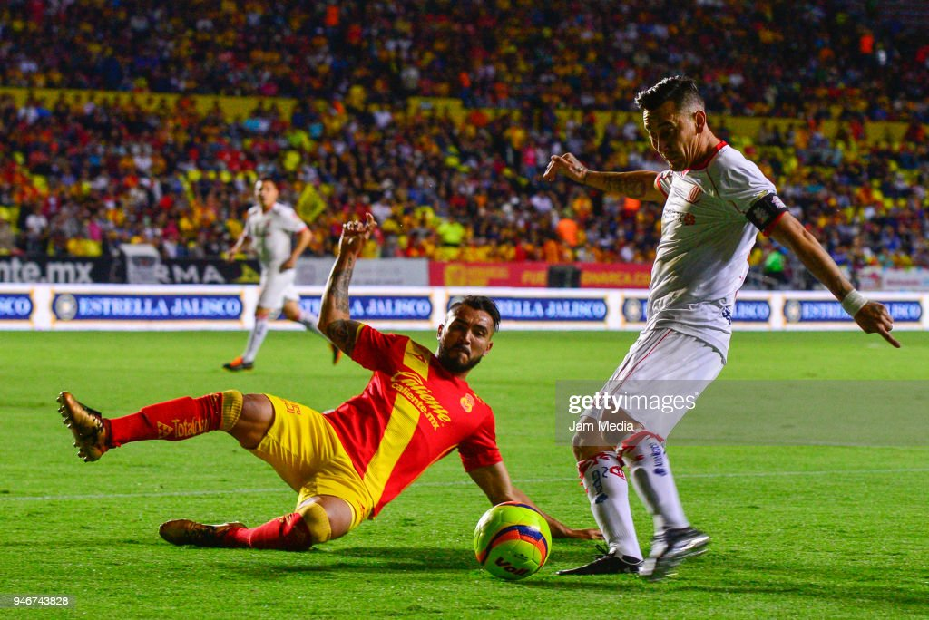 Aldo Rocha (L) of Morelia and Rubens Sambueza (R) of Toluca fight for the ball during the 15th round match between Morelia and Toluca as part of the Torneo Clausura 2018 Liga MX at Jose Maria Morelos Stadium on April 14, 2018 in Morelia, Mexico.