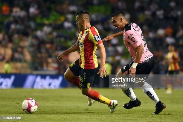 Aldo Rocha of Morelia and Walter Gonzalez of Leon fight for the ball during the 12th round match between Leon and Morelia as part of the Torneo...