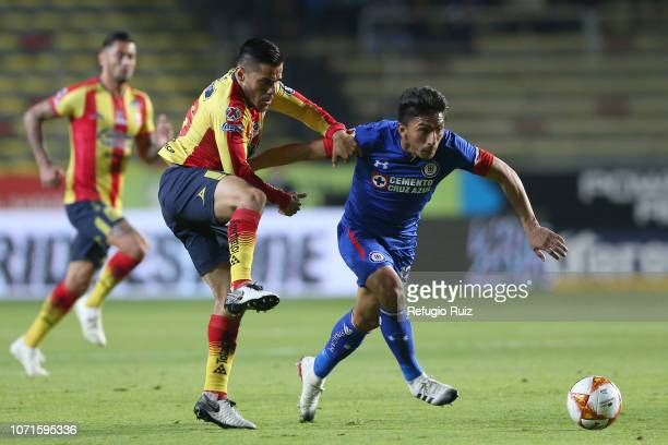 Aldo Rocha of Morelia fights for the ball with Angel Mena of Cruz Azul during a match between Morelia and Cruz Azul as part of Torneo Apertura 2018...