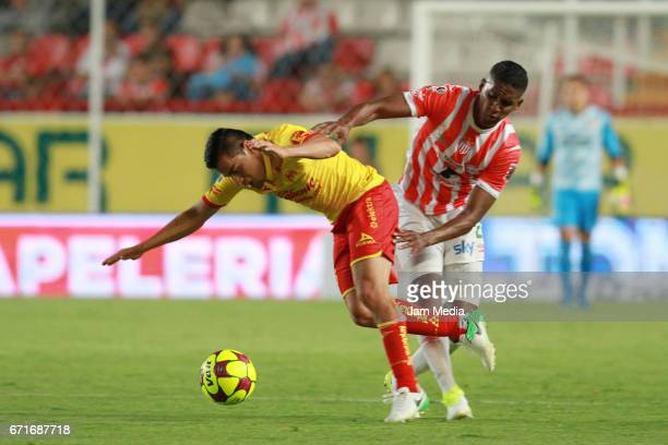 Aldo Rocha of Morelia fights for the ball with Brayan Beckeles of Necaxa during the 15th round match between Necaxa and Morelia as part of the Torneo...
