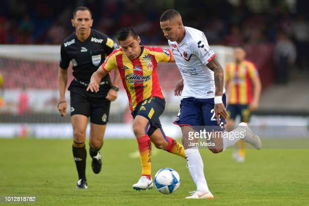 Aldo Rocha of Morelia fights for the ball with Diego Chavez of Veracruz during the third round match between Veracruz and Morelia as part of the...