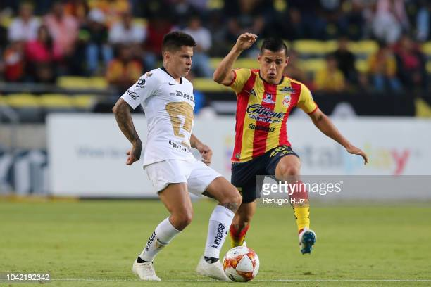 Aldo Rocha of Morelia fights for the ball with Juan Iturbe of Pumas during the 10th round match between Morelia and Pumas UNAM as part of the Torneo...