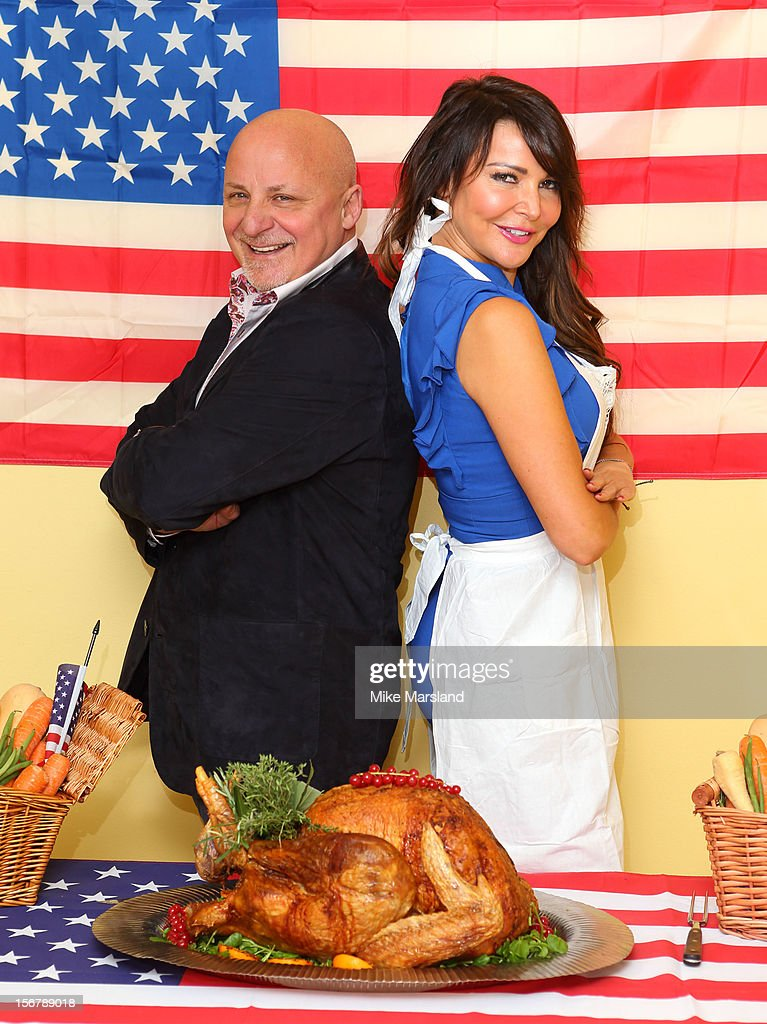 Aldo Zilli and Lizzie Cundy attend The Marylebone Project's Thanksgiving meal for homeless women in conjunction with the American InterContinental University on November 21, 2012 in London, England.