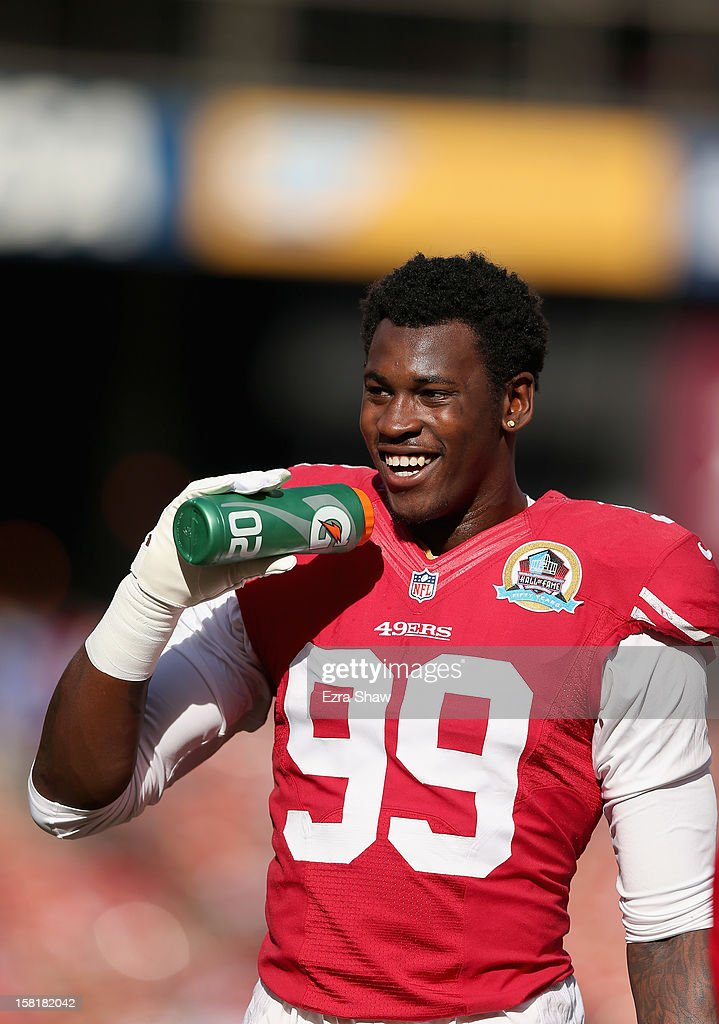 Aldon Smith #99 of the San Francisco 49ers drinks from a Gatorade water bottle before their game against the Miami Dolphins at Candlestick Park on December 9, 2012 in San Francisco, California.
