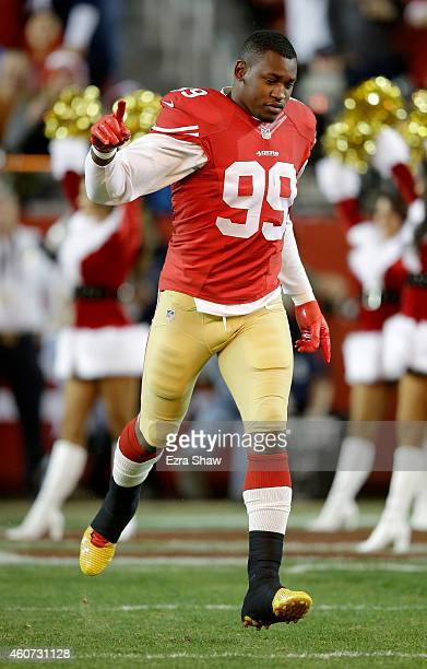 Aldon Smith of the San Francisco 49ers runs on the field before taking on the San Diego Chargers at Levi's Stadium on December 20 2014 in Santa Clara...
