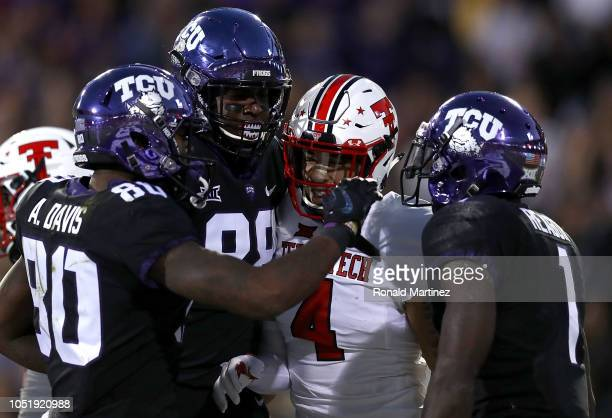 Al'Dontre Davis and Artayvious Lynn celebrate a touchdown with Jalen Reagor of the TCU Horned Frogs in front of Desmon Smith of the Texas Tech Red...