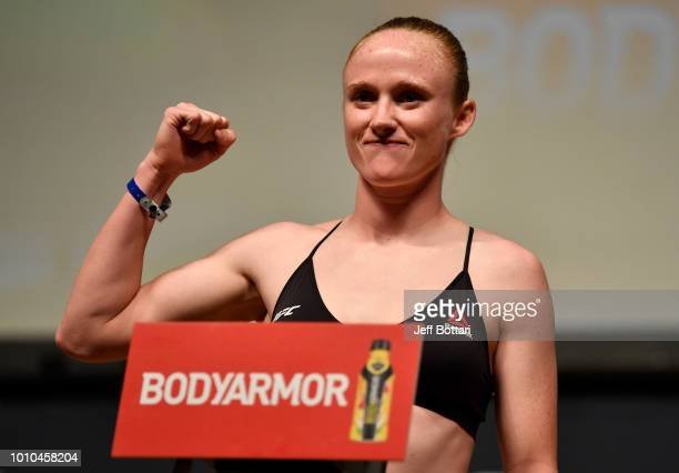 Aldrich poses on the scale during the UFC 227 weighin inside the Orpheum Theater on August 3 2018 in Los Angeles California