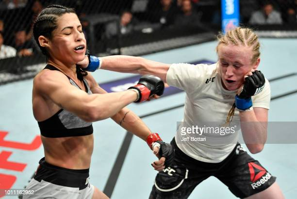 JJ Aldrich punches Polyana Viana of Brazil in their women's strawweight fight during the UFC 227 event inside Staples Center on August 4 2018 in Los...