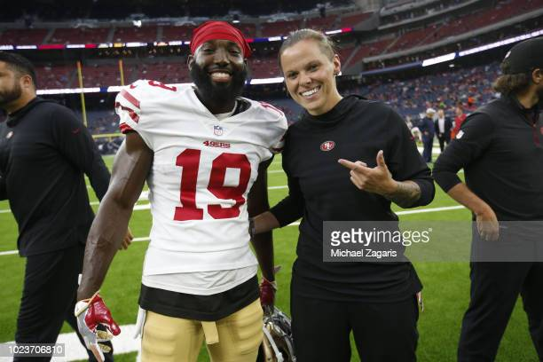 Aldrick Robinson and Seasonal Offensive Assistant Coach Katie Sowers of the San Francisco 49ers stand on the field prior to the game against the...