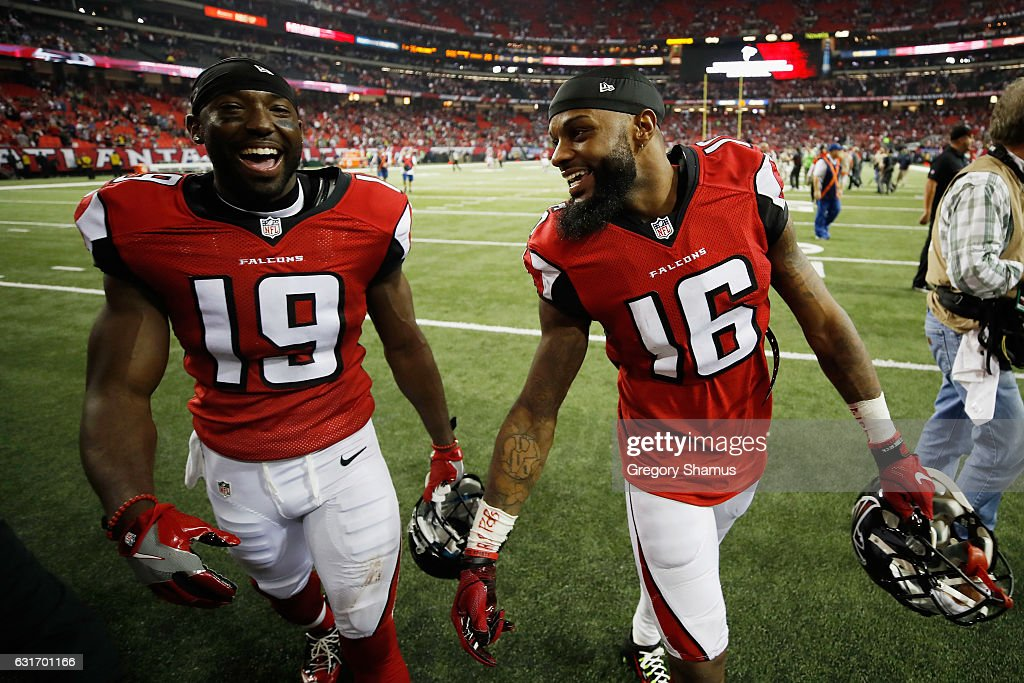 Aldrick Robinson #19 of the Atlanta Falcons and Justin Hardy #16 of the Atlanta Falcons react after beating the Seattle Seahawks at the Georgia Dome on January 14, 2017 in Atlanta, Georgia.