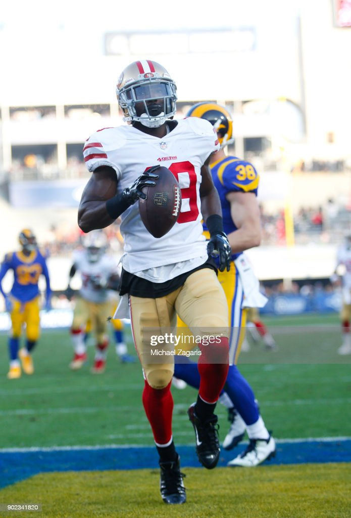 Aldrick Robinson #19 of the San Francisco 49ers scores on a 12-yard touchdown reception during the game against the Los Angeles Rams at Los Angeles Memorial Coliseum on December 31, 2017 in Los Angeles, California. The 49ers defeated the Rams 34-13.