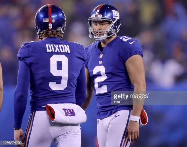 Aldrick Rosas of the New York Giants is congratulated by teammate Riley Dixon after Rosas kicked the game winning field goal in overtime against the...