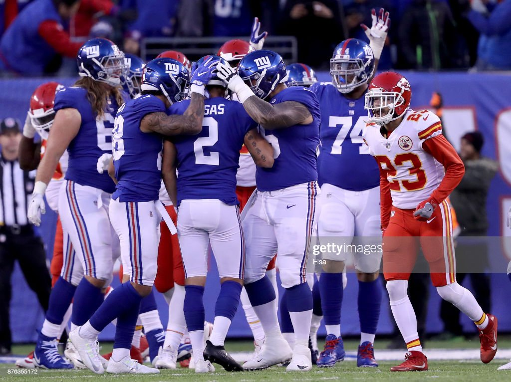 Aldrick Rosas #2 of the New York Giants is congratulated by teammates Evan Engram #88 and Jon Halapio #75 of the New York Giants after Rosas kicked the game winning field goal in overtime to win the game against the Kansas City Chiefs on November 19, 2017 at MetLife Stadium in East Rutherford, New Jersey. The New York Giants defeated the Kansas City Chiefs 12-9 in overtime.