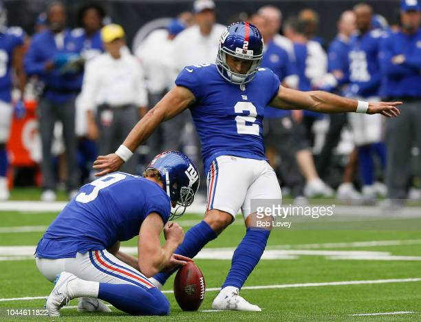Aldrick Rosas of the New York Giants kicks a field goal out of the hold of Riley Dixon against the Houston Texans at NRG Stadium on September 23 2018...