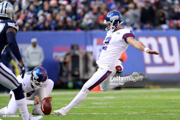 Aldrick Rosas of the New York Giants kicks the ball against the Dallas Cowboys in the first half during the game at MetLife Stadium on December 10...