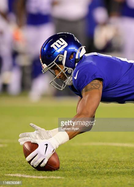 Aldrick Rosas of the New York Giants recovers his own fumble on a punt return during the first half against the Chicago Bears during a preseason game...