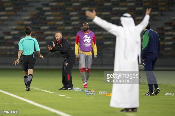 alDuhail's head coach Djamel Belmadi of France reacts during the AFC Champions League round 2 group B stage football match at the Zayed Sports City...