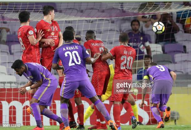 AlDuhail's players jump to defend as AlAin's Ahmed Khalil scores during the AFC Champions League match AlAin vs AlDuhail at Hazza Bin Zayed Stadium...