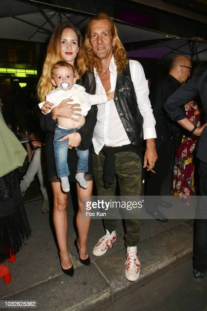 Ale de Basseville his son Luxifer and his wife Egla Harxhi attend the Stefanie Renoma Exhibition Preview Party at Le Masha Club on September 12 2018...